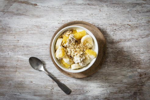 Bowl of granola with oat flakes, natural yoghurt, ananas and banana - EVGF03126