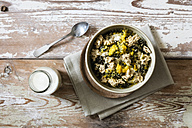 Bowl of semolina pudding with passion fruit and oat flake crumble - EVGF03138