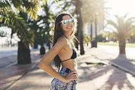 Portrait of young woman, waering beach wear - GIOF02391
