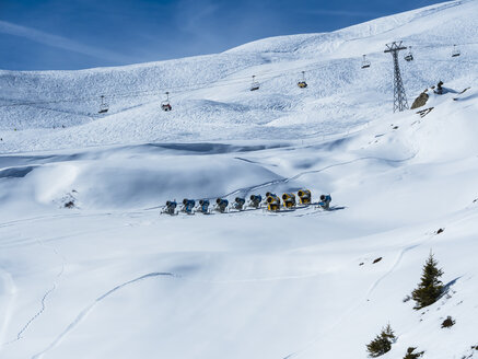 Switzerland, Canton of Bern, Grindelwald, Kleine Scheidegg, snow cannons and chair lift - AMF05357