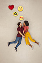 Happy couple, falling in love with emojies over their heads - BAEF01251