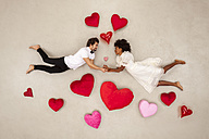 Young couple falling in love with hearts around - BAEF01260
