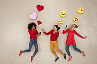 Female friends chatting and gossiping with emojies over their heads - BAEF01281