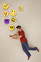 Man chatting on his smart phone, sending emojies - BAEF01296