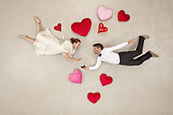 Man proposing to woman with hearts around - BAEF01323