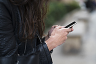 Close-up of woman using a cell phone - KKAF00522