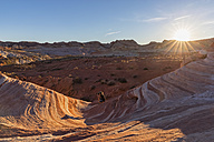 USA, Nevada, Valley of Fire State Park, woman taking pictures of colored sandstone and limestone rocks of the Fire Wave - FOF09099