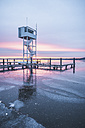 Germany, Berlin, Mueggelsee with diving tower in winter at sunrise - ASCF00731