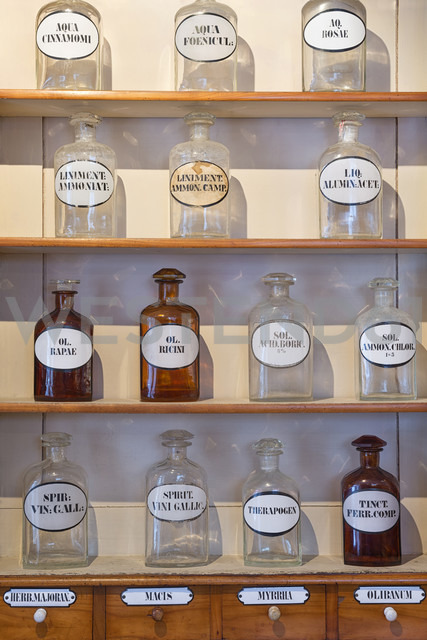 Germany, Radolfzell, shelves with glass bottles of historical pharmacy at municipal museum - SHF01958