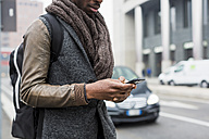 Man wearing autumn fashion text messaging - MAUF00985