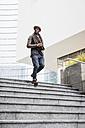 Man walking down stairs - MAUF01003