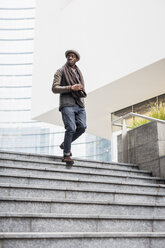 Man walking down stairs - MAUF01003