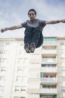 Young man doing Parkour in the city - SKCF00277