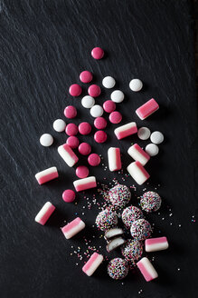 Various pink and white candies, peppermint candy, choclate buttons, fondant balls - CSF28141