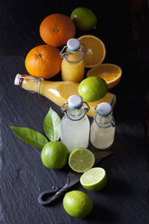 Freshly squeezed lime and orange juice in a swing top bottles - CSF28165