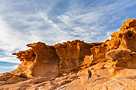 USA, Nevada, Little Finland, hiker in front of sandstone rock formations - FOF09119