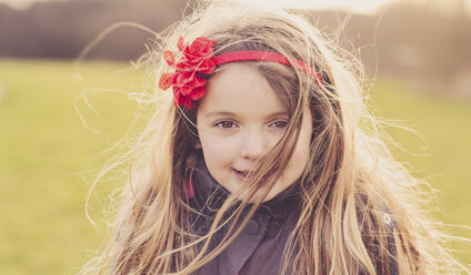 Portrait of little girl wearing hair band - NMSF00025