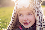 Portrait of shy little girl wearing hat with leopard print - NMSF00028