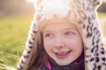 Portrait of shy little girl wearing hat with leopard print - NMSF00028