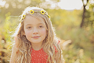 Portrait of relaxed little girl wearing flower wreath - NMSF00031