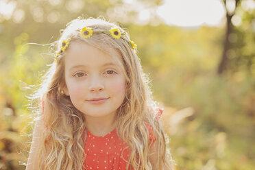 Portrait of relaxed little girl wearing flower wreath - NMSF00031