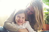 Mother and daughter having fun at home - RTBF00766