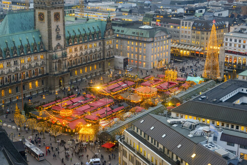 Germany, Hamburg, Christmas market at city hall in the evening - RJF00686