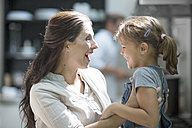 Amazed mother and daughter in kitchen - ZEF13230