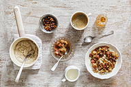 Breakfast with bowl of porridge with rhubarb compote, honey and nuts and cup of coffee - EVGF03155
