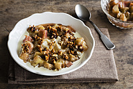 Bowl of porridge with rhubarb compote, honey and nuts - EVGF03158