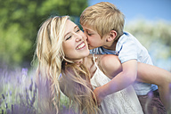 Happy mother with son in lavender field - ZEF13234