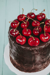 Cherries on cake with chocolate icing - RTBF00787