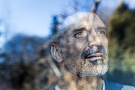 Mature man looking out of window - TCF05352