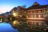 France, Strasbourg, La Petite France, with half-timbered houses and L'Ill river in the foreground at blue hour - PUF00599