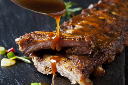 Barbecue sauce dripping on marinated and grilled spare ribs - CSF28218