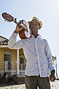 Cuba, portrait of man with guitar on his shoulder - MAUF01023