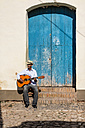 Cuba, man playing guitar on the street - MAUF01032