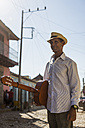 Cuba, Trinidad, man with guitar on the street - MAUF01041