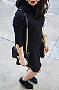 Fashionable young woman dressed in black - GIOF02529