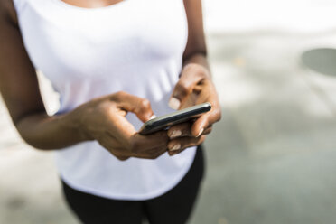 Woman text messaging, partial view - GIOF02535