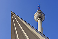 Germany, Berlin, Alexanderplatz, Low angle view of television tower - RUEF01768