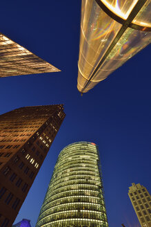 Germany, Berlin, Potsdamer Platz, skyscrapers  illuminated at dusk - RUEF01777