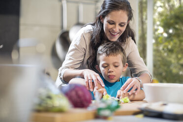Mother and son chopping vegetables in kitchen - ZEF13319