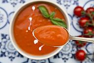 Spoon of tomato cream soup, close-up - LVF05963