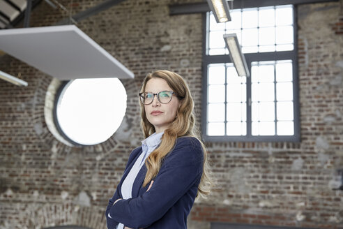 Portrait of confident businesswoman in a loft - FMKF03705