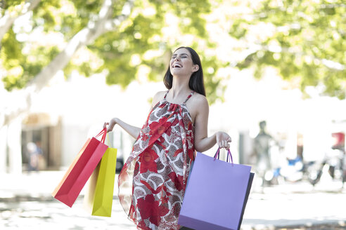 Happy young woman with shopping bags - ZEF13383