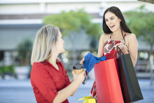 Two happy women with shopping bags - ZEF13386