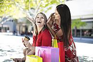 Two happy women with shopping bags - ZEF13389