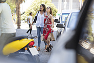 Happy mother and daughter with shopping bags in the city - ZEF13401