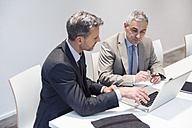 Two businessmen working together in office - DIGF01534